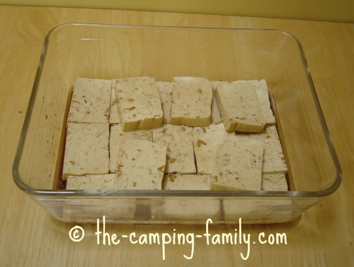 tofu and marinade in glass baking dish