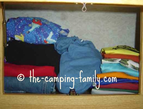 small cloth bag in RV cupboard with clothing