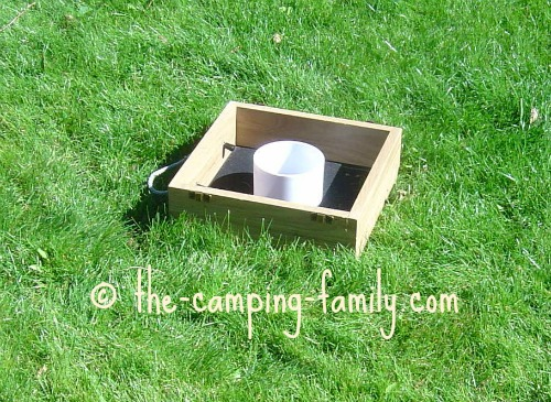 washer toss game on grass