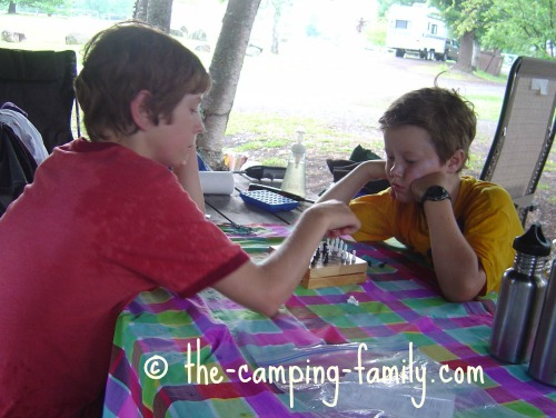 playing chess at the picnic table