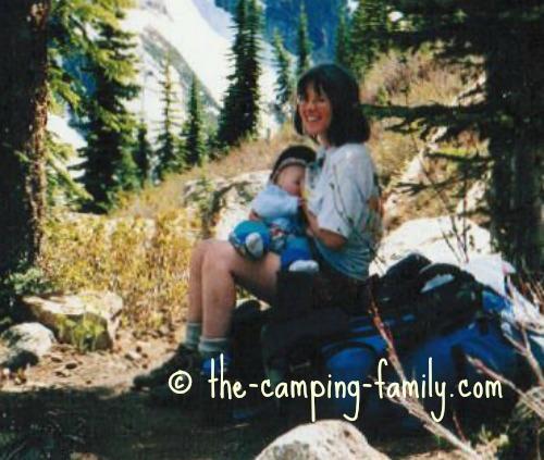 feeding baby on trail