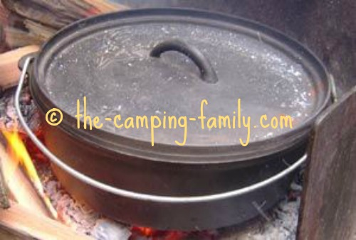 ashes on lid of Dutch oven
