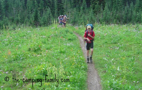 backpackers in meadow