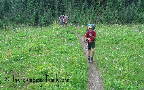 backpackers in meadow