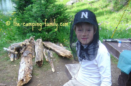 boy wearing mosquito headnet