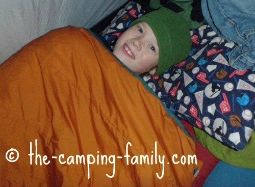 happy boy in sleeping bag