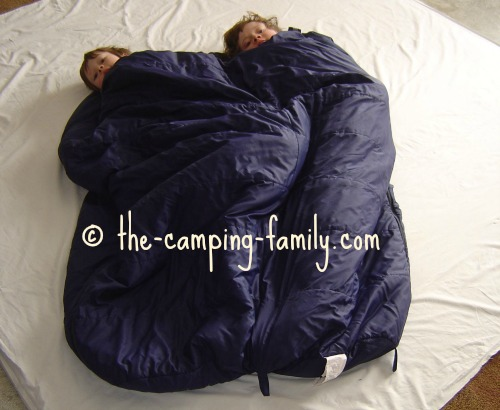 boys in sleeping bags zipped together