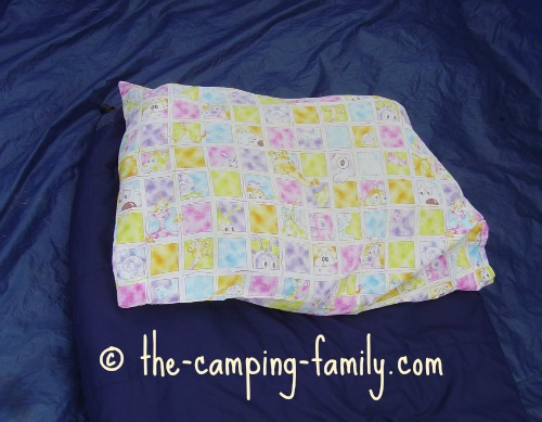 pillowcase stuffed with clothing