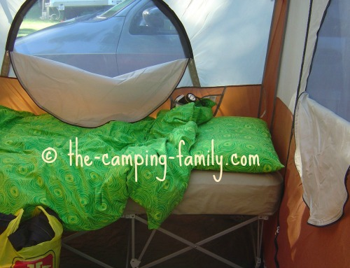 folding camping cot in cabin style tent