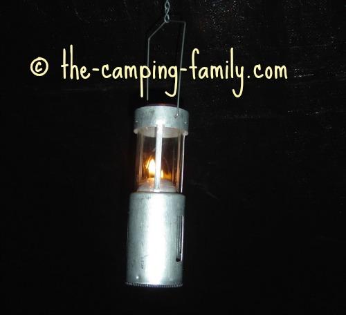 candle lantern hanging in the dark