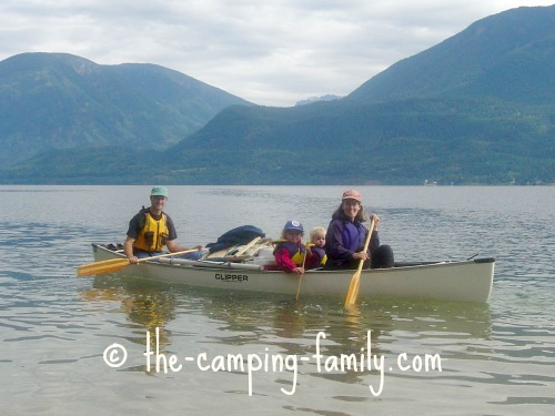 family and gear in canoe