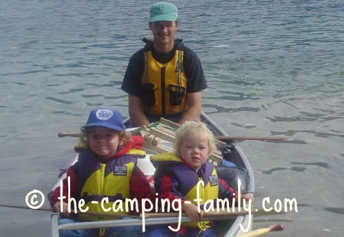dad and boys in canoe with PFDs