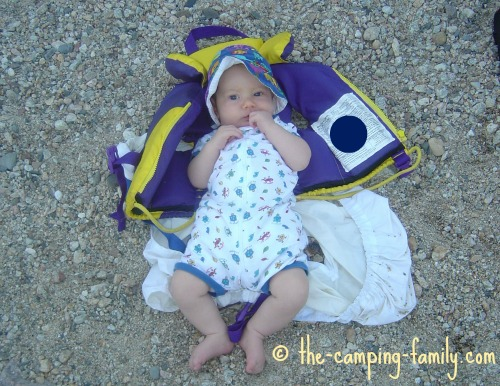baby wearing sunsuit