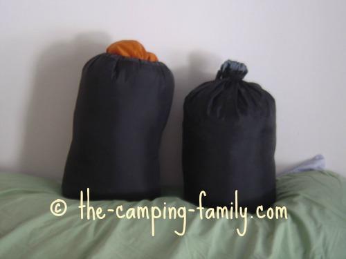 two sleeping bags in stuff sacks