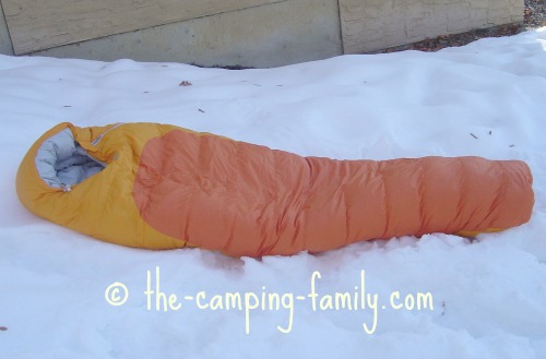 down filled sleeping bag on the snow