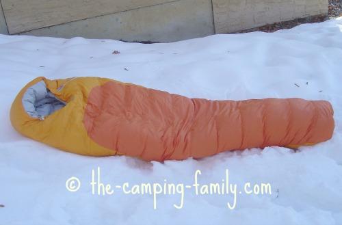 down sleeping bag on the snow