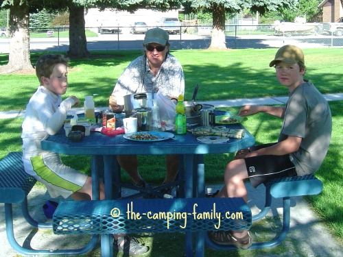 family at picnic table in park