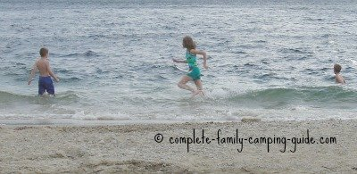kids playing in waves