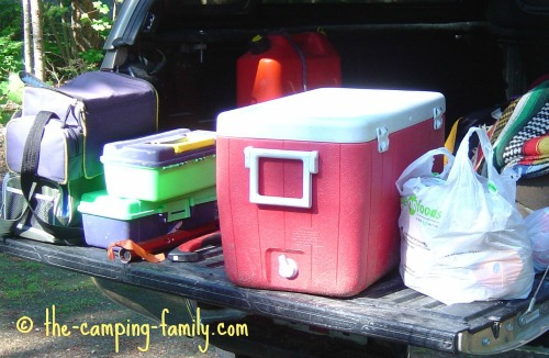 cooler and gear in back of truck