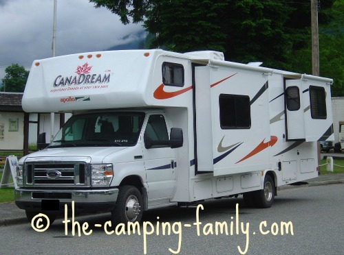 motorhome with slide-outs parked on road