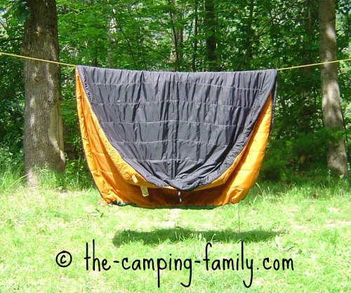 synthetic sleeping bag on clothesline