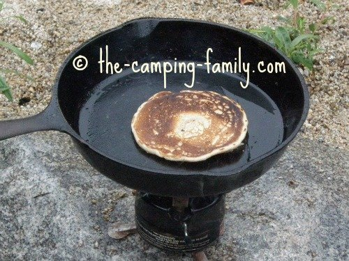 pancake in skillet on backpacking stove