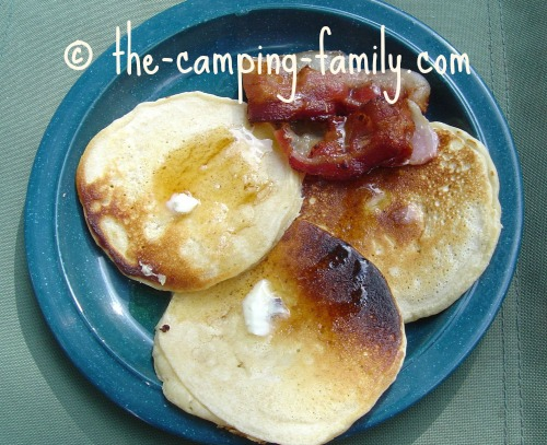 pancakes and bacon on a camping plate