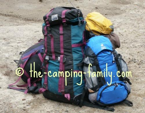 pile of loaded backpacks