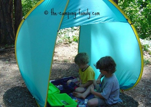 boys in pop up tent shelter