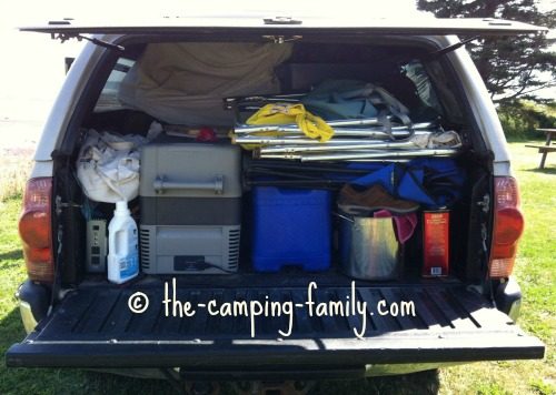 camping fridge in a packed pickup truck