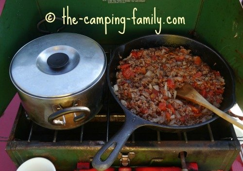 camping stove with pot and skillet