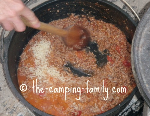 adding rice to Dutch oven