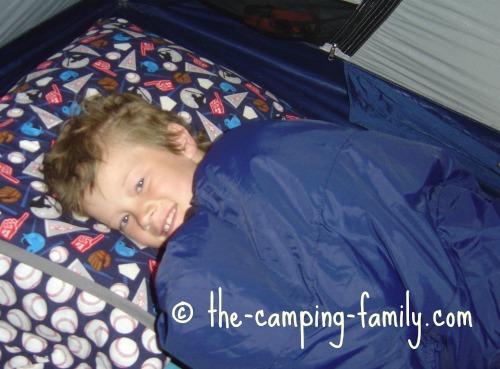 boy in childrens sleeping bag