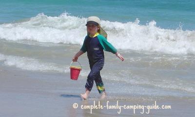 boy in SPF sunsuit