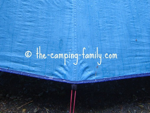 raindrops flowing down tent fly