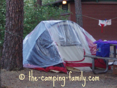 tent draped with clear tarp