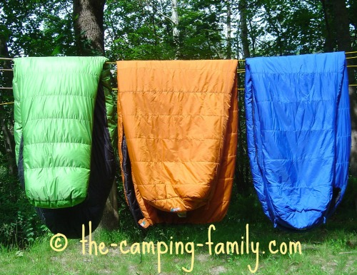 three sleeping bags on the clothesline
