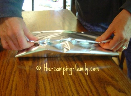 folding down the foil packet