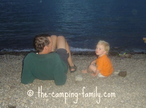 toddler and dad on the beach at night