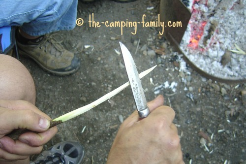 whittling a marshmallow stick